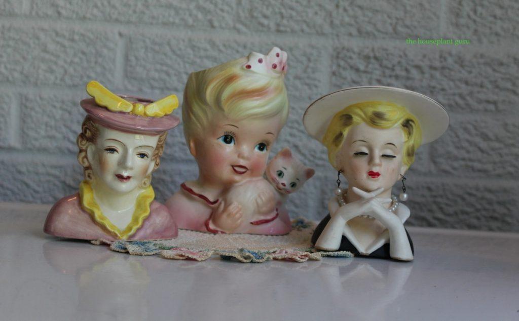 Three antique head vases